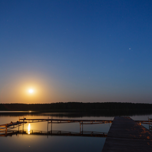 """""""Evening landscape of moon rise over calm lake"""" stock image"""