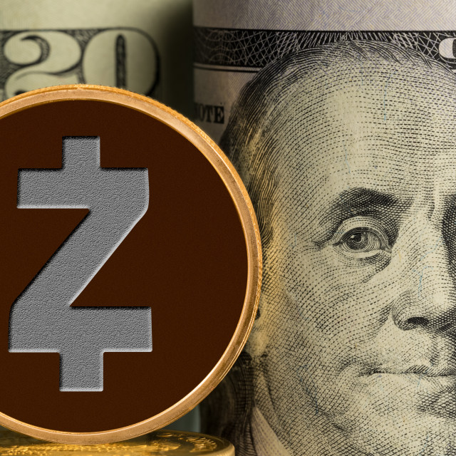 """""""Single Zcash coin in front of bank rolls of US currency"""" stock image"""