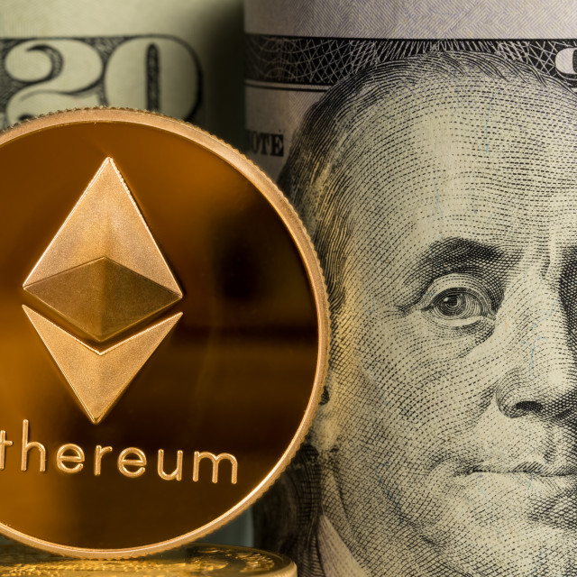 """""""Single Ethereum coin in front of bank rolls of US currency"""" stock image"""