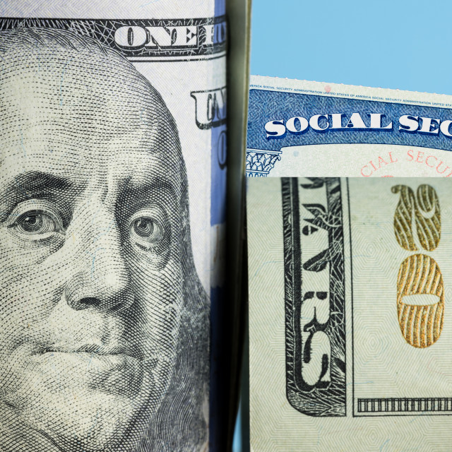 """Social Security Card behind Benjamin Franklin on US 100 dollar note"" stock image"