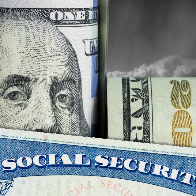 """""""Social Security Card in front of Benjamin Franklin on dollar note"""" stock image"""