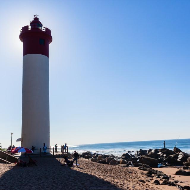 """Beach Ocean Lighthouse Backlight People"" stock image"