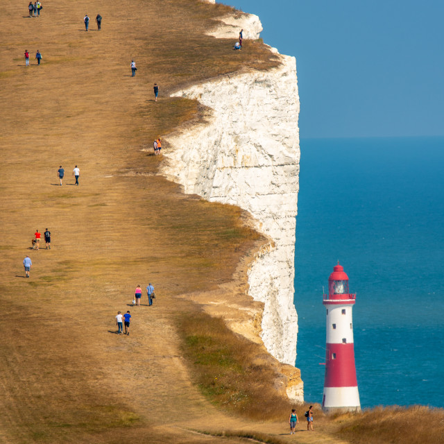 """Beachy Head lighthouse, people and cliffs"" stock image"