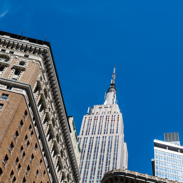 """Low angle view of buildings against sky in Midtown of Manhattan"" stock image"