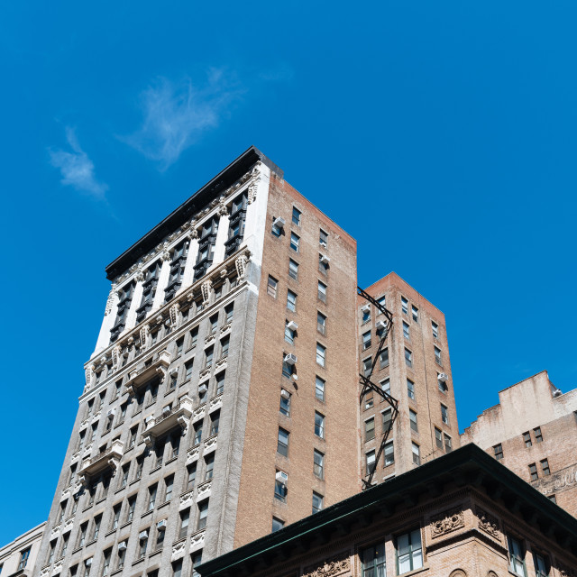 """Low angle view of old buildings and water towers in New York Cit"" stock image"