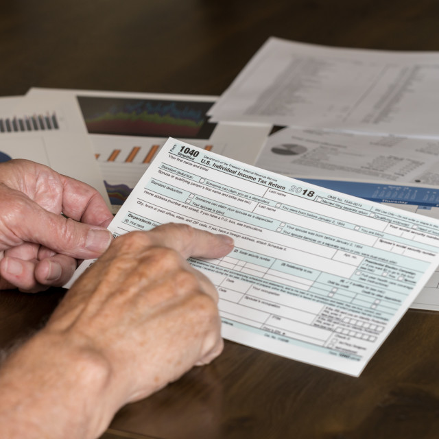 """""""Form 1040 Simplified allows filing of taxes on postcard"""" stock image"""