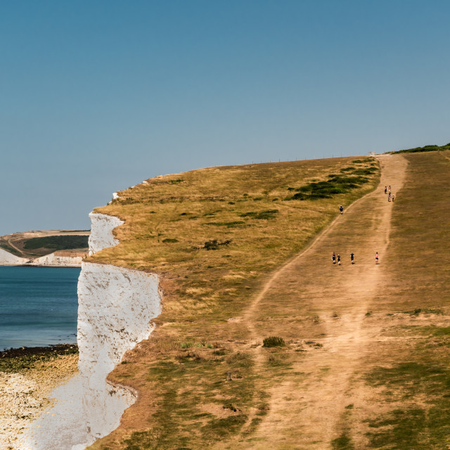 """Walkers on the Seven Sisters"" stock image"