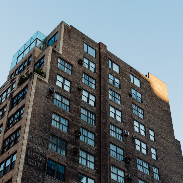 """Low angle view of old brick buildings in New York City"" stock image"