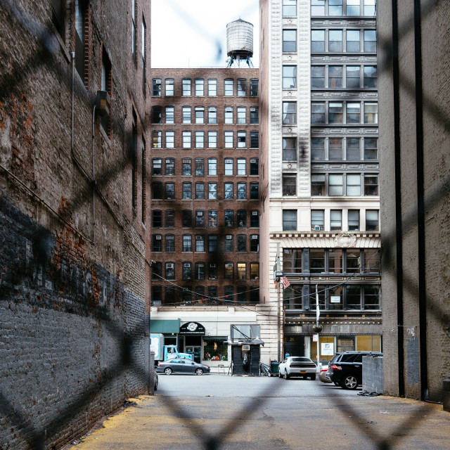 """Alley in New York City. View through fence"" stock image"