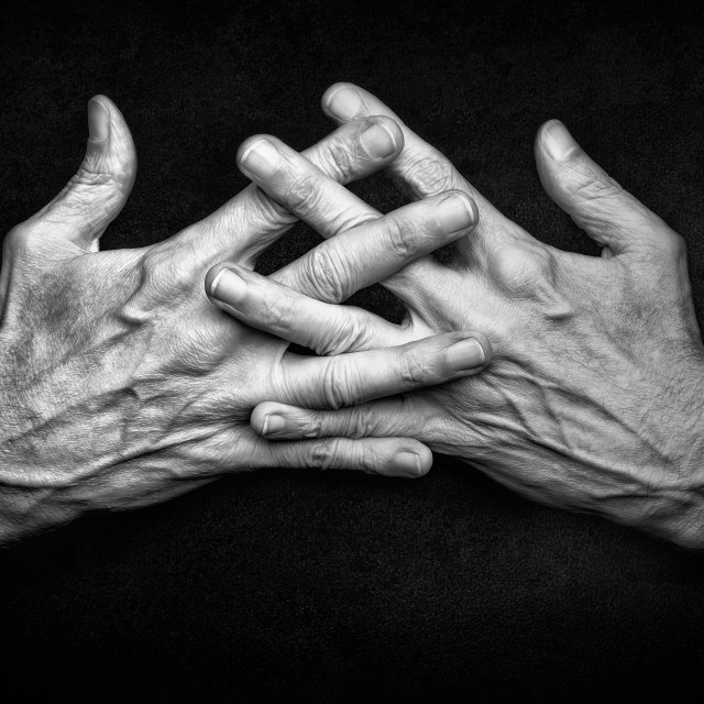 """""""Crossed man's hands with crossed fingers"""" stock image"""