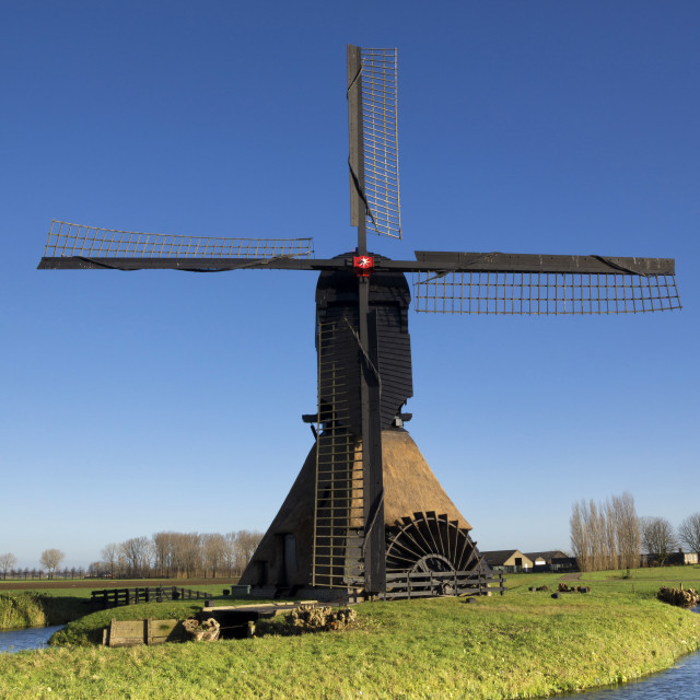 """Noordeveldse windmill with a clear blue sky"" stock image"