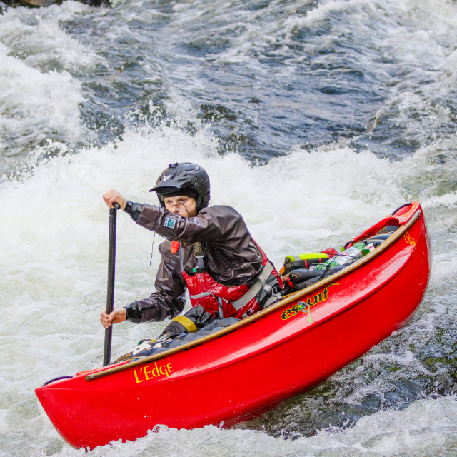 """""""Paddling on the Lyn River in an open canoe"""" stock image"""