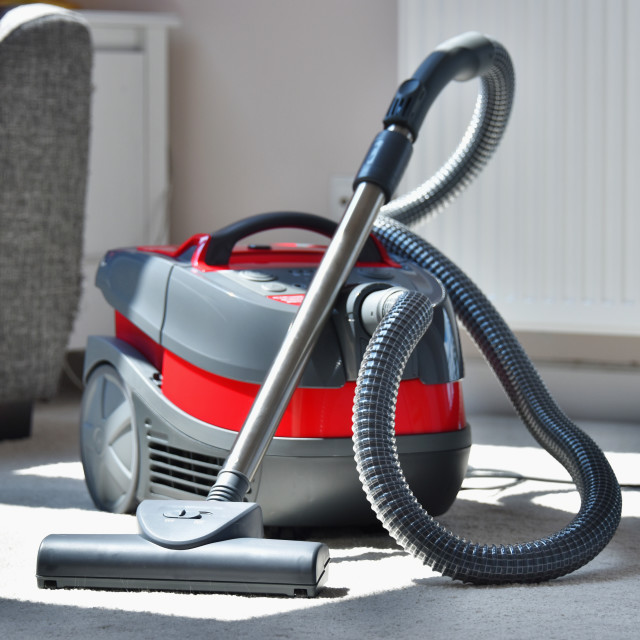 """""""Canister vacuum cleaner for home use on the floor"""" stock image"""
