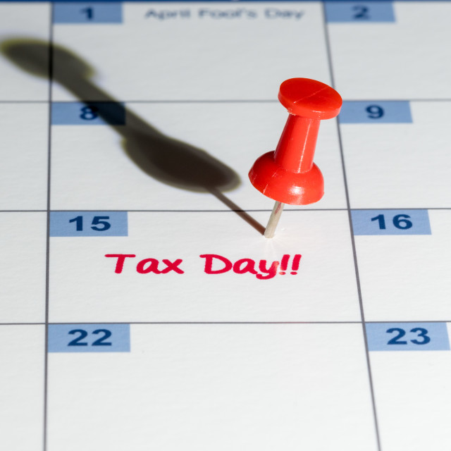"""""""Red pushpin in calendar on April 15th for tax day"""" stock image"""
