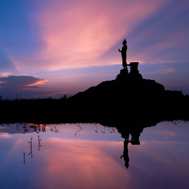 """Silhouette of very large statue of buddha"" stock image"