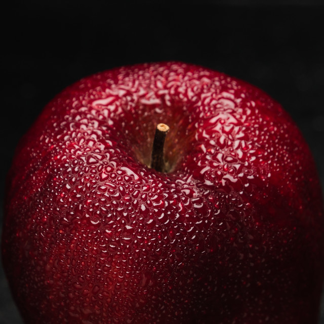 """Drops on red apple"" stock image"