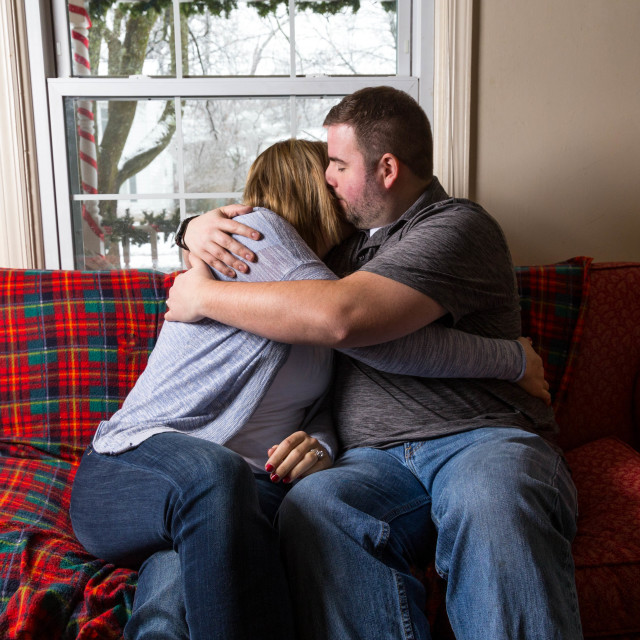 """""""A Young Caucasian Couple Excitedly Waits And Prays For Good News"""" stock image"""