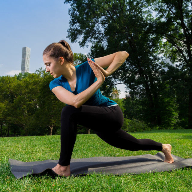 """Young Caucasian Woman Practices Yoga In Central Park NYC While W"" stock image"
