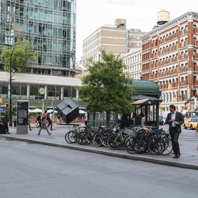 """Street scene in New York with people crossing and bicycles"" stock image"