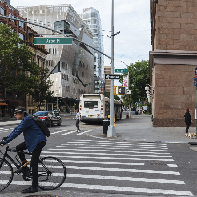 """Cyclist is waiting for crossing street in New York City"" stock image"