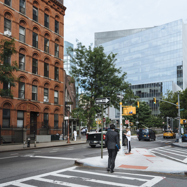 """Rear view of man crossing Stuyvesant Street in East New YorkManh"" stock image"