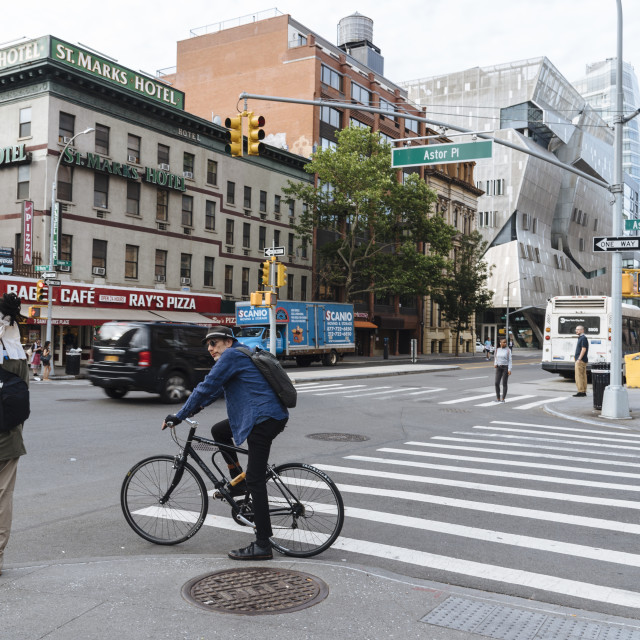 """Woman and cyclist are waiting for crossing street in New York"" stock image"