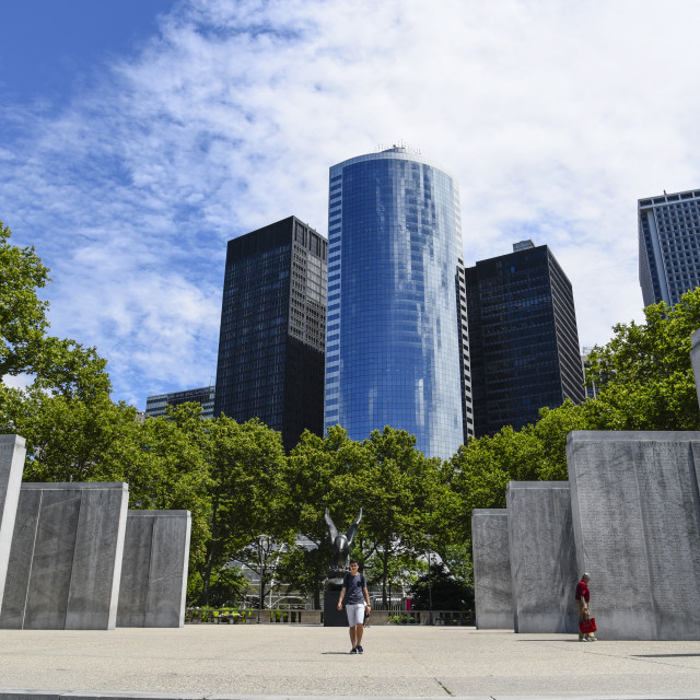 """East Coast Memorial against skyscrapers in Battery Park"" stock image"