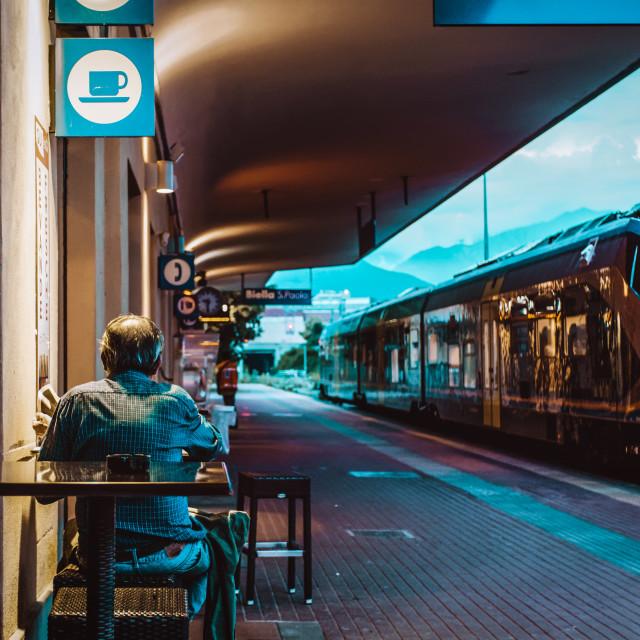 """Senior drinks coffee on train station"" stock image"