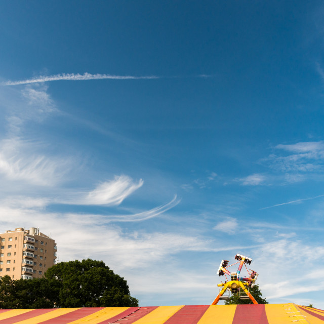 """Blue Skies over a Funfair's Tent"" stock image"