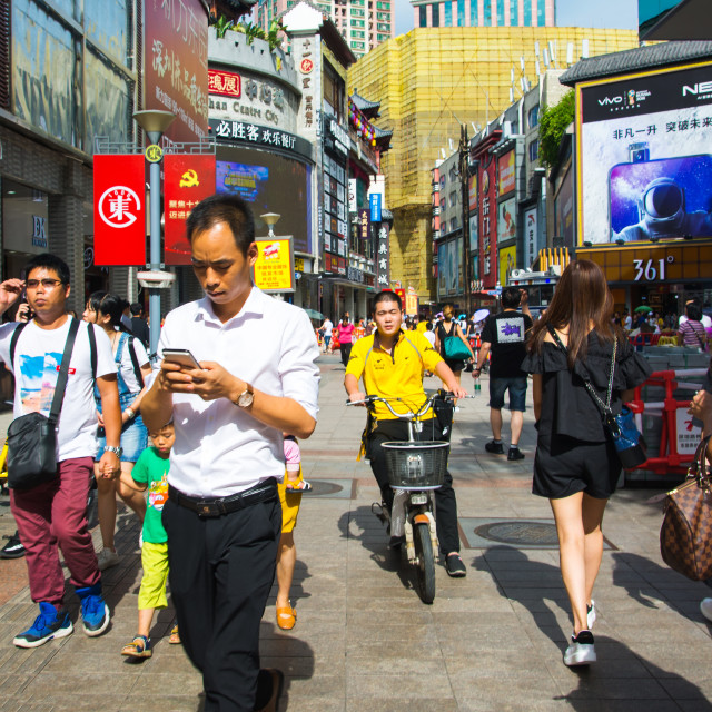 """Busy Dong Men Pedestrian street in the old Shenzhen city area crowded with people on a sunny day"" stock image"
