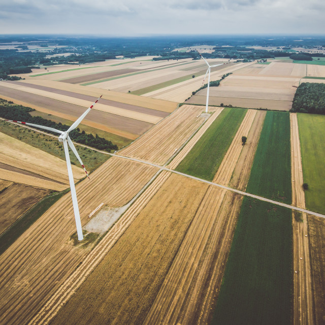 """""""Aerial view of windmill against cloudy sky"""" stock image"""