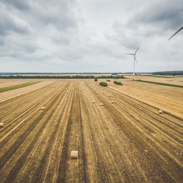 """Aerial view of windmill against cloudy sky"" stock image"