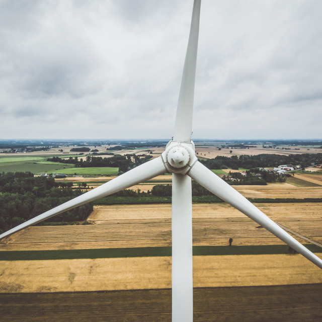 """Aerial close-up of windmill turbine"" stock image"
