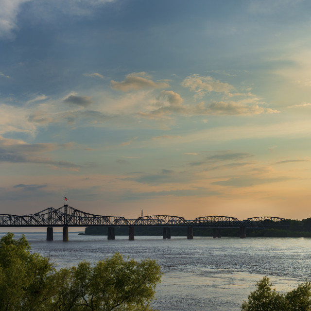 """View of the Mississippi River with the Vicksburg Bridge on the background at sunset; Concept for travel in the USA and visit Mississippi"" stock image"
