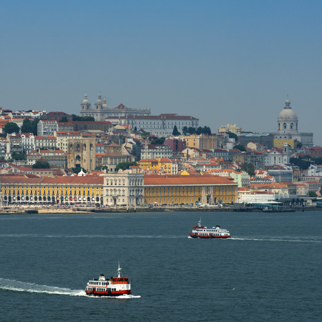 """View of the skyline of the city of Lisbon with boats (cacilheiro) on the Tagus River; Concept for travel in Portugal and visit Lisbon"" stock image"