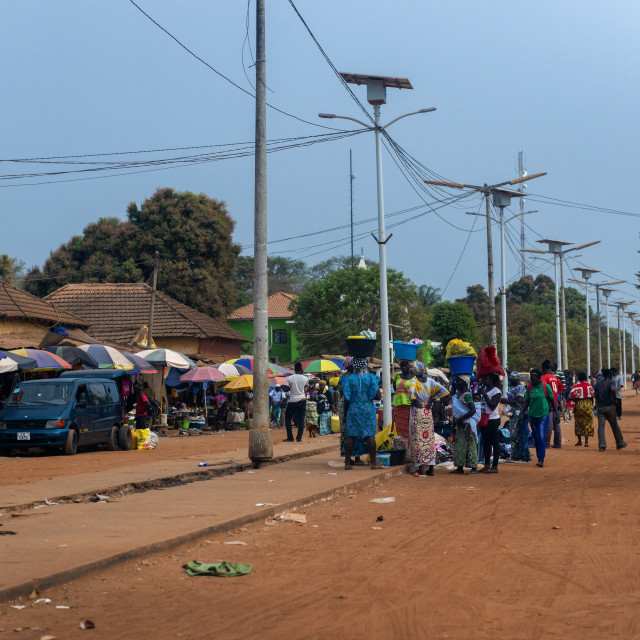 """Canchungo, Republic of Guinea-Bissau - February 1, 2018: People in a street market in the town of Canchungo in Guinea Bissau, West Africa."" stock image"