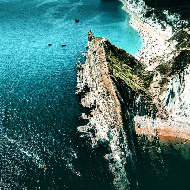"""Drone shot over durdle door"" stock image"