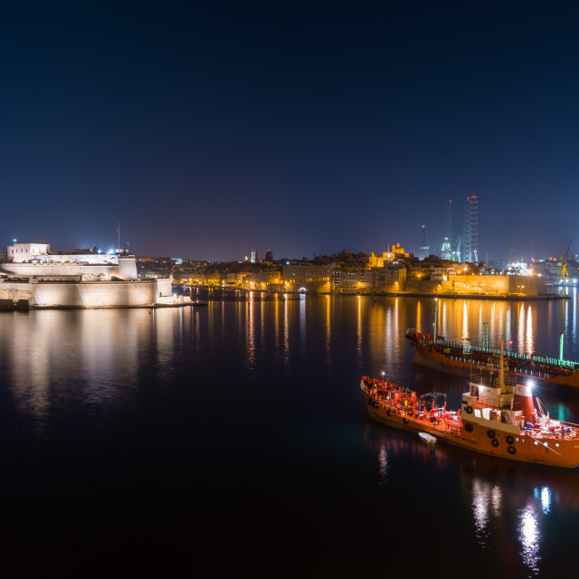 """Valletta port at night with anchored ships and Vauban fort, in Malta."" stock image"