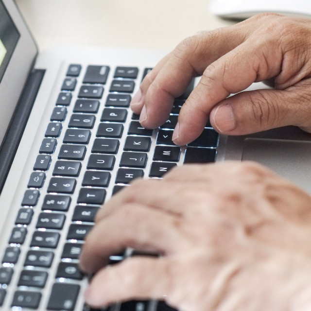 """Fingers typing on keyboard"" stock image"