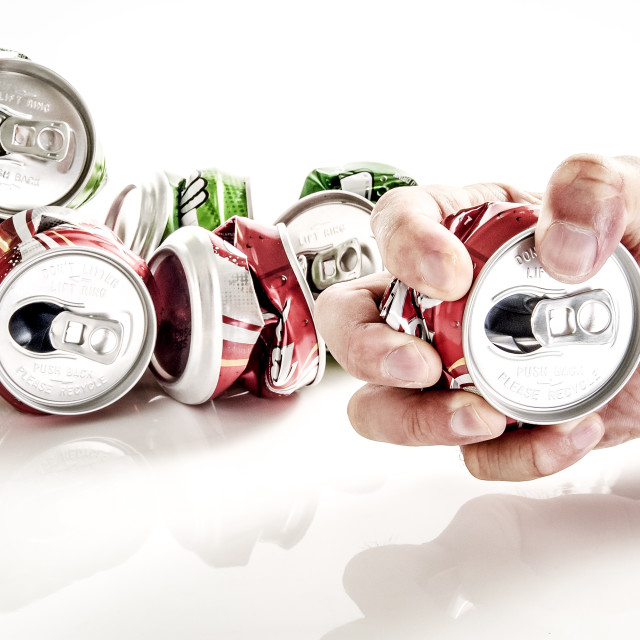 """Hand Crushing Empty Soda Can"" stock image"