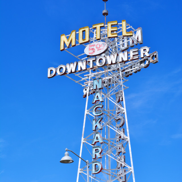 """Neon Sign of the Downtowner Motel."" stock image"