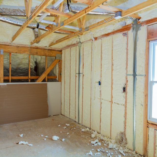 """Insulation of attic with foam polyurea insulation cold barrier and insulation..."" stock image"