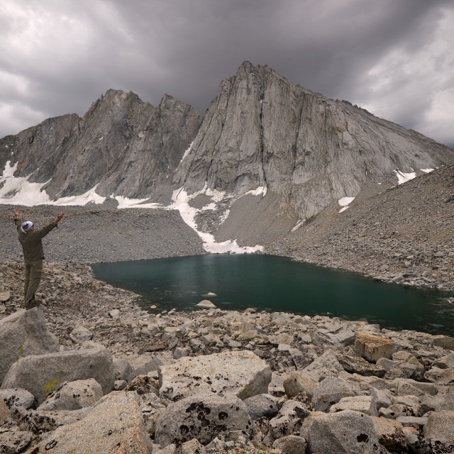 """Hiker Standing With his Arms Outstretched Before Mount Tyndall"" stock image"
