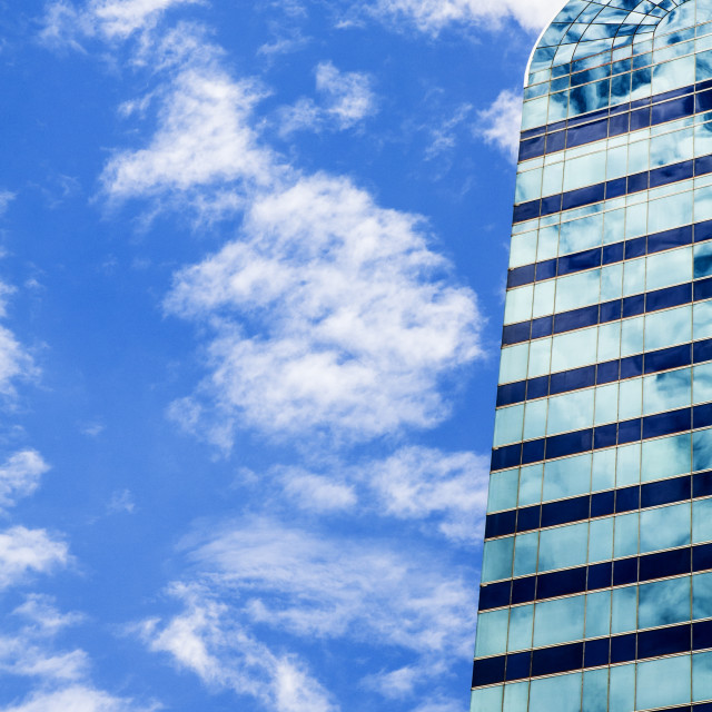 """Glass Windows Reflection Against Blue Sky"" stock image"