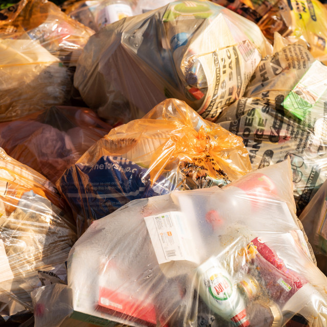 """""""Recycling plastic waste sacks in a pile awaiting collection"""" stock image"""
