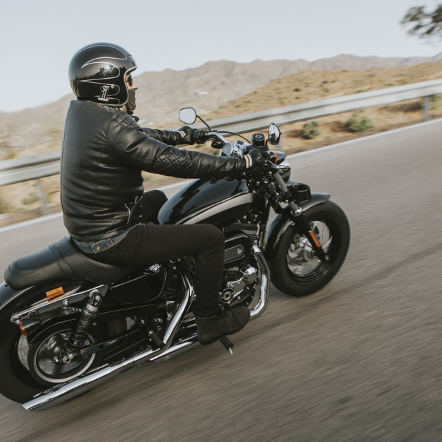 """""""Man in black clothes riding a black classic american motorcycle"""" stock image"""