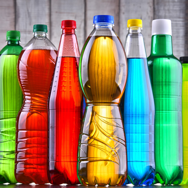 """""""Plastic bottles of assorted carbonated soft drinks"""" stock image"""