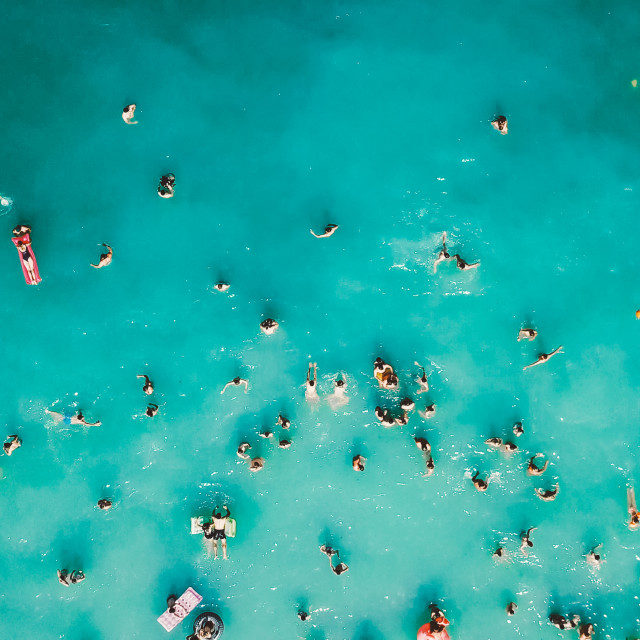 """Aerial View From Flying Drone Of People Crowd Having Fun, Playing And Relaxing In Water At The Black Sea In Romania"" stock image"