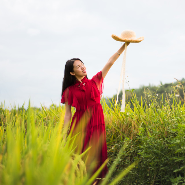 """Girl in a rice field wearing red dress"" stock image"