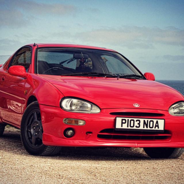 """My Mazda MX-3 at Slains Castle, Scotland"" stock image"